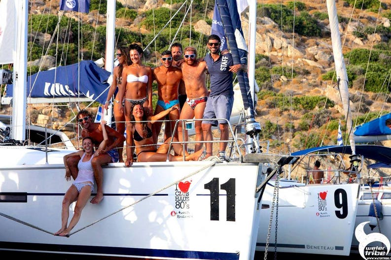 Young people on sailboat enjoying party