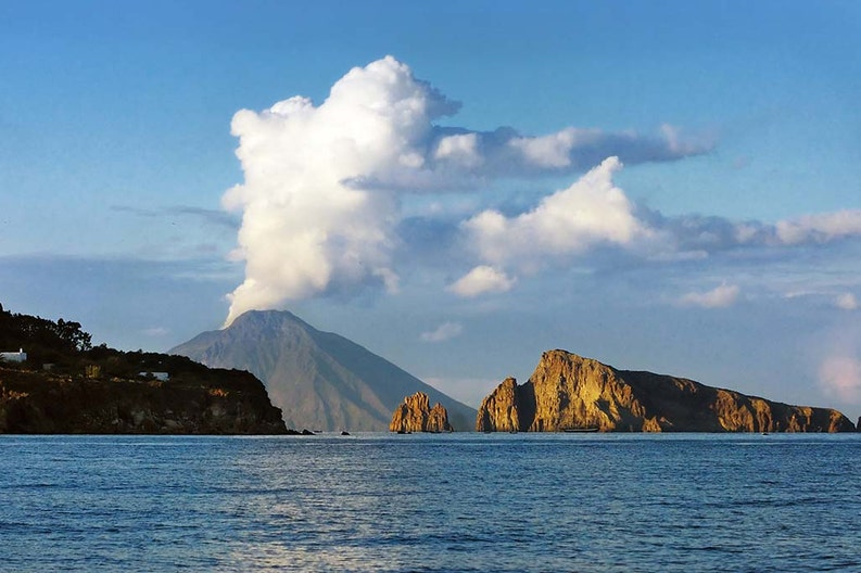 View from the sea of the island of Ponterosa in the Aeolian archipelago in Italy