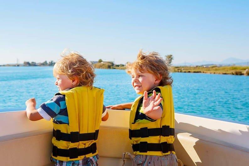 Children vacation on sailboat