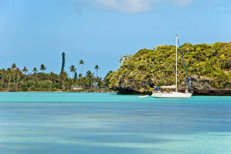 Catamaran in front of Ile des Pins in New Caledonia
